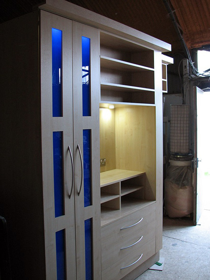 The Blue In These Maple Veneer Wardrobes Adds Colour And Also Ties The Large  Amount Of Storage Into The Room As It Matches The Clients Colour Theme.